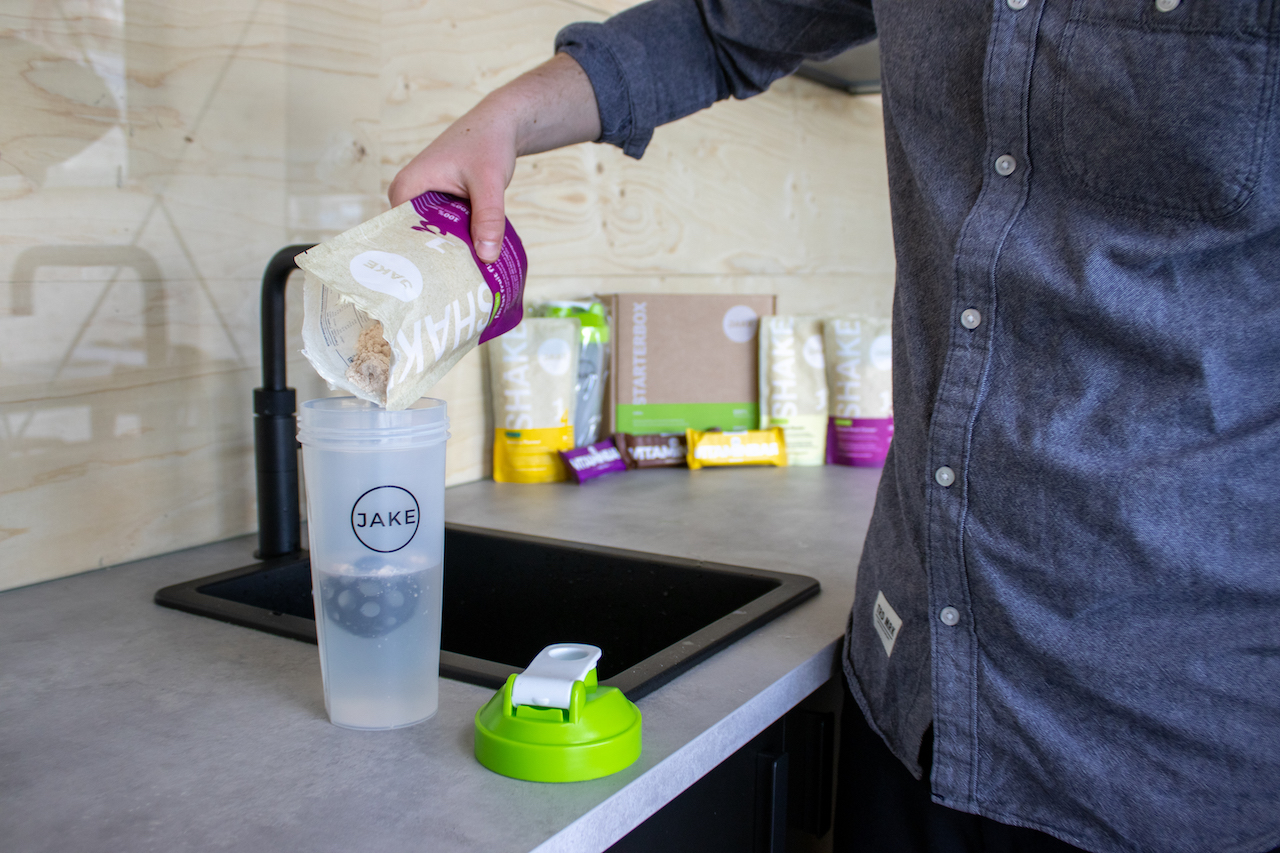 Man pouring a shake into shaker